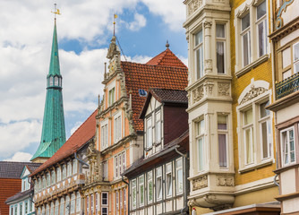 Fototapete - Colorful facades and church tower in the center of Hameln