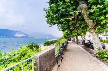View of Maggiore lake and promenade at summer day, Italy