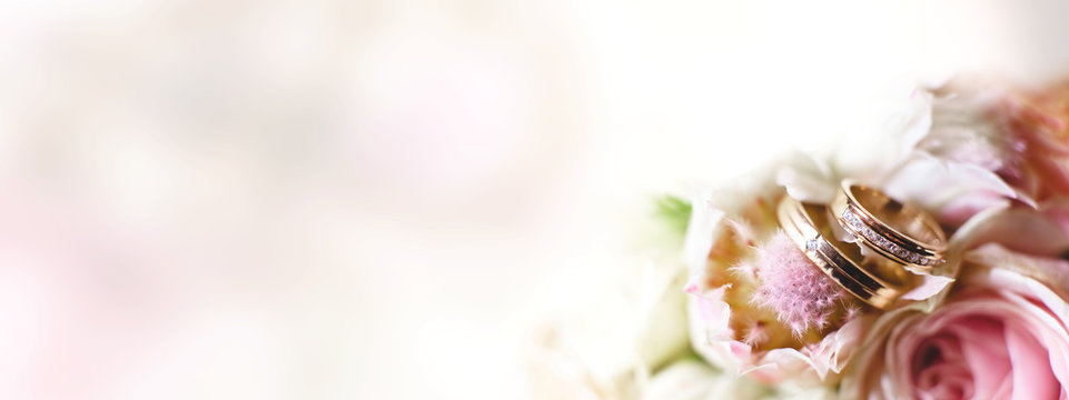 Background with wedding rings in light tone