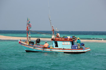 Fishing boat fishing in the open sea for a big fish