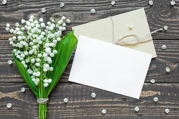 blank white greeting card and envelope with white lily of the valley flowers Wall mural