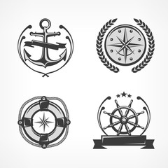Nautical symbols, anchor, steering wheel, compass, lifebuoy.