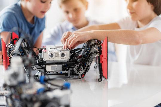 Busy interested children using robotics