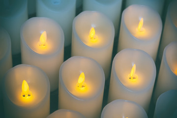 Candles light background of candles group In church