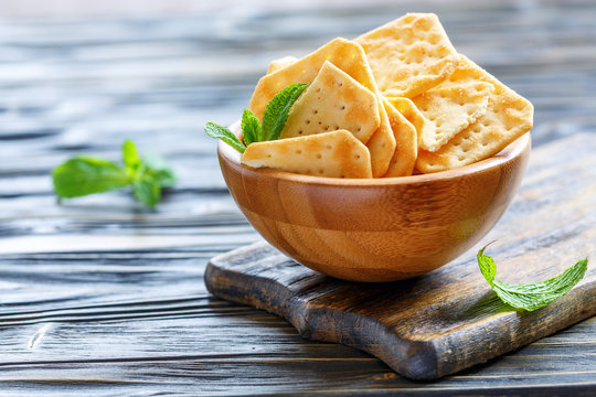 Crispy crackers with salt in a wooden bowl.