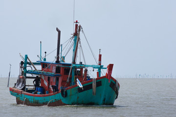 Fishing boat over muddy water at Sabak Bernam, Malaysia