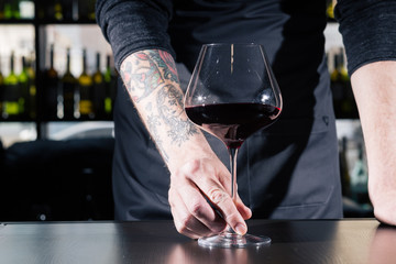 male sommeliers holds ed wine
