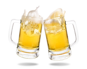 Cheers cold beer with splashing out of glasses on white background.