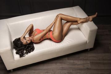 Seductive brunette beauty posing in studio
