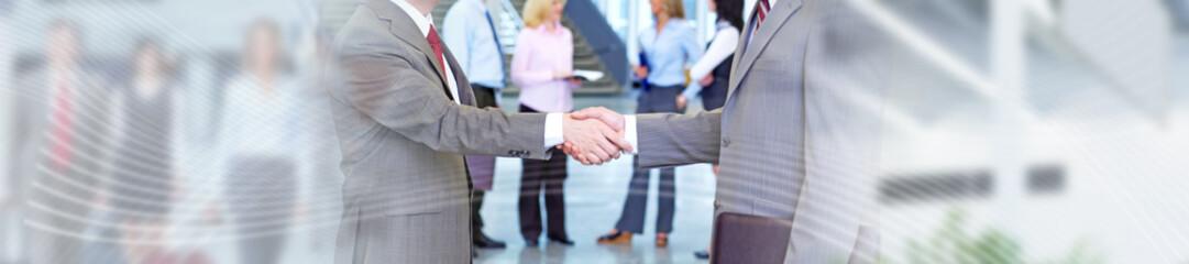 Business meeting handshake.