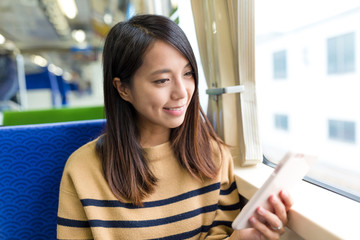 Woman travel on train and use of cellphone