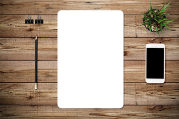 Top view of blank paper page on wood background office desk with smart phone and different objects. Minimal flat lay style
