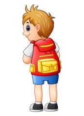 Cute boy in a school uniform with backpack