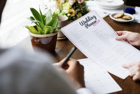Hands Holding Wedding Planner Checklist Information Preparation