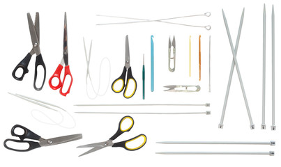 Scissors, hooks and needles of different sizes. Isolate. White background.