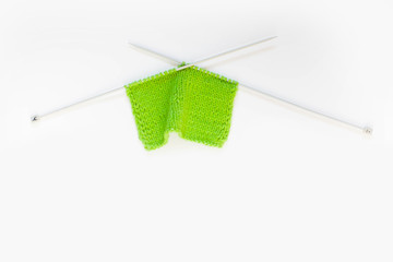 Knitted green. Yarn for knitting green. White background.