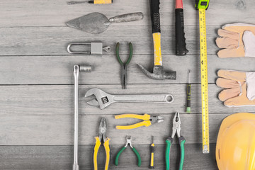 Set of construction tools  on wooden background top view. construction industry flat lay concept
