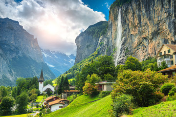 Fabulous mountain village with high cliffs and waterfalls, Lauterbrunnen, Switzerland Fototapete