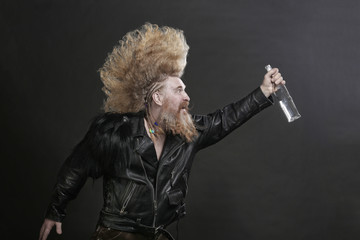 biker in black leather jackets with a bottle