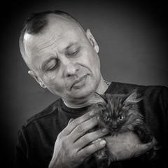 man with a kitten