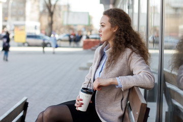 beautiful curly girl in a coat