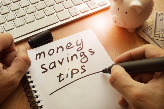 Money saving tips written in a note.