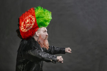 biker in black leather jackets and high mohawk with the Afghan flag