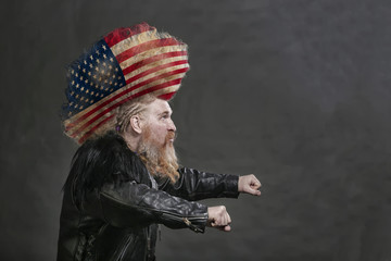 biker in black leather jackets and high mohawk with US flag
