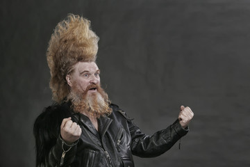 adult biker in black leather jackets and high mohawk