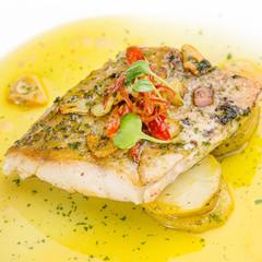 Fish fillet in butter lemon sauce
