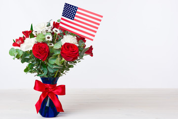 Beautiful bouquet with american flag on white background