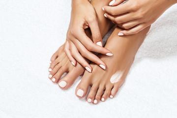 Beautiful female feet with moisturizing cream.