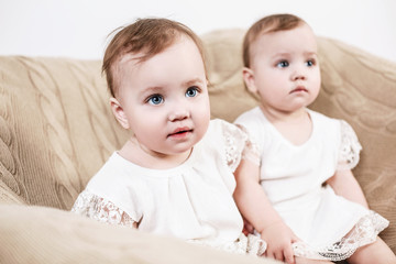 Two adorable baby twin girls.