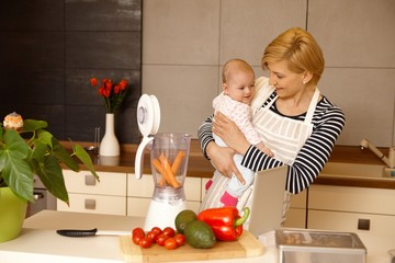 Young mother preparing baby food