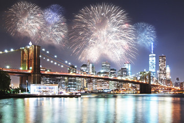 Night city with fireworks backdrop