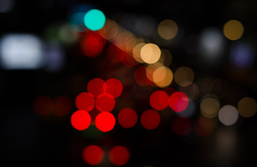 Bokeh street light background in night.Red tone blur bokeh light background.