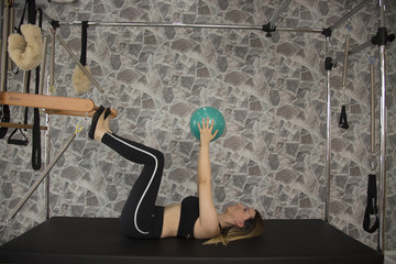 Woman do pilates with ball