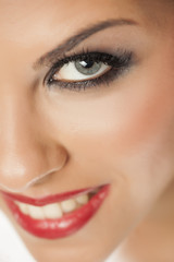 A smiling pretty woman with blue eyes and artificial lashes