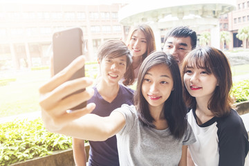 Group of happy friends taking a selfie