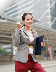 Beautiful young business woman expression fight outside. Asian businesswoman office worker in downtown business district.