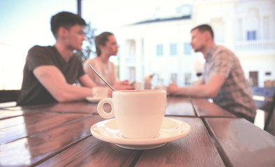 cup of coffee on table in cafe.