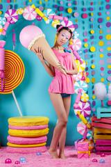 funny Korean girl with ice cream in Studio