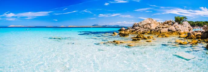 Obraz Clear amazing azure coloured sea water with gtanote rocks in Capriccioli beach, Sardinia, Italy - fototapety do salonu