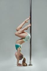 Fototapeta Junior acrobat on pylon at pole dance studio obraz