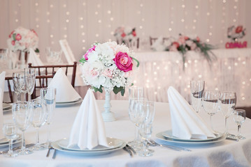 Restaurant interior for banquet, wedding. Glass, napkins and cutlery.