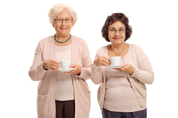 Two mature women with cups