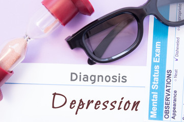 Diagnosis of Depression. Hourglass, doctor glasses, mental status exam are near inscription Depression. Causes, symptoms, diagnosis and treatment of this mental illness