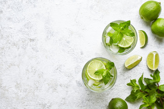 Mojito cocktail alcohol bar long drink traditional Cuba fresh tropical beverage top view copy space two highball glass