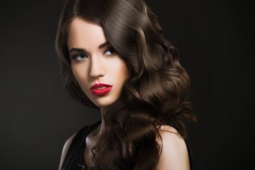 Beautiful woman, glamour portrait on dark background