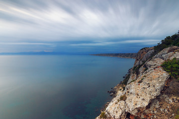 Landscape view from cliff at Tolleric Mallorca with motion blur clouds